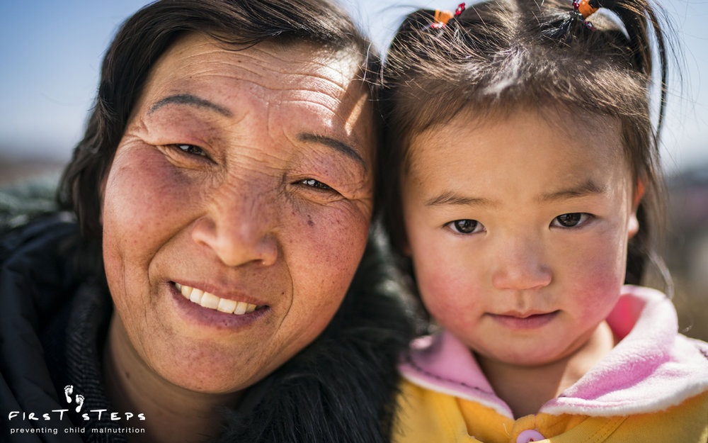 Four-year-old Shin Na-Re and her grandma, Ri Yon-Ok were two of the happy faces greeting us outside when we arrived at the Shinmi Clinic.