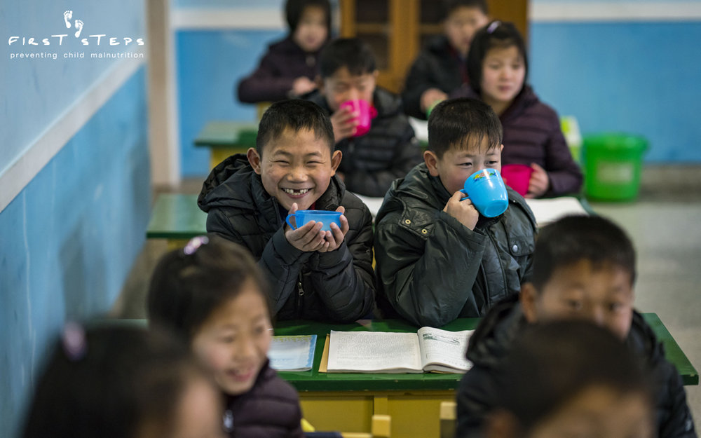 At the boarding school, there are smiles all around during the morning soymilk break.