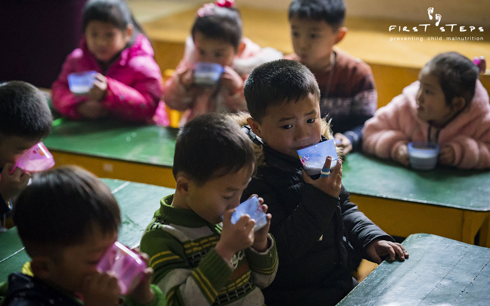 Each of the 250 children attending the Poha Kindergarten receive a morning cup of soymilk.