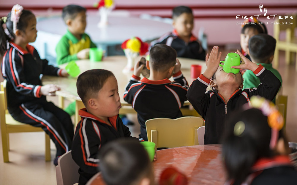 One of the beneficiaries of the soymilk produced at the Nampo Foodstuff Factory is the Nampo Kindergarten Orphanage. The children enjoy their soymilk - right to the very last drop!