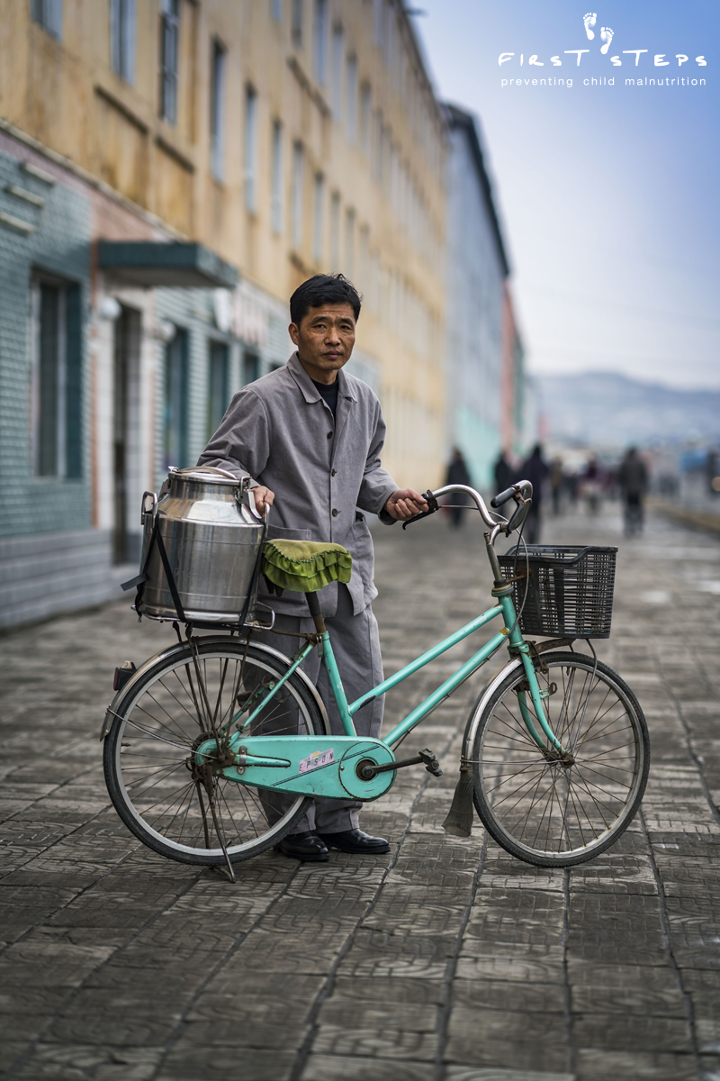 Mr. Yon with his soymilk delivery bike in front of the Hanggu Daycare and Kindergarten Supply Centre in Nampo
