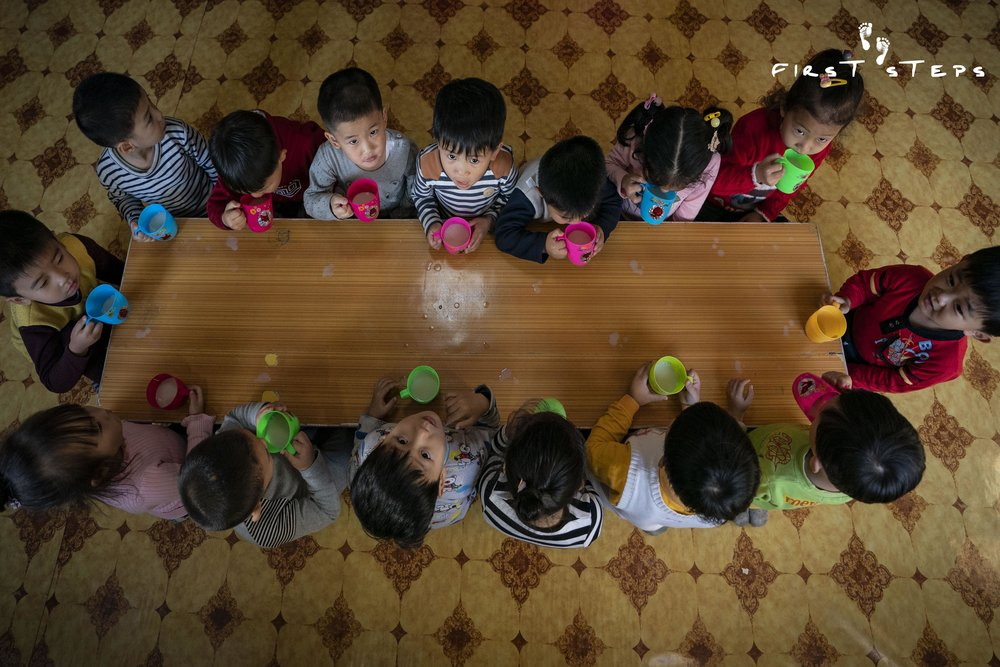 At the Wonsan Weekly Daycare, children aged six months to four years old receive freshly prepared soymilk on a daily basis.