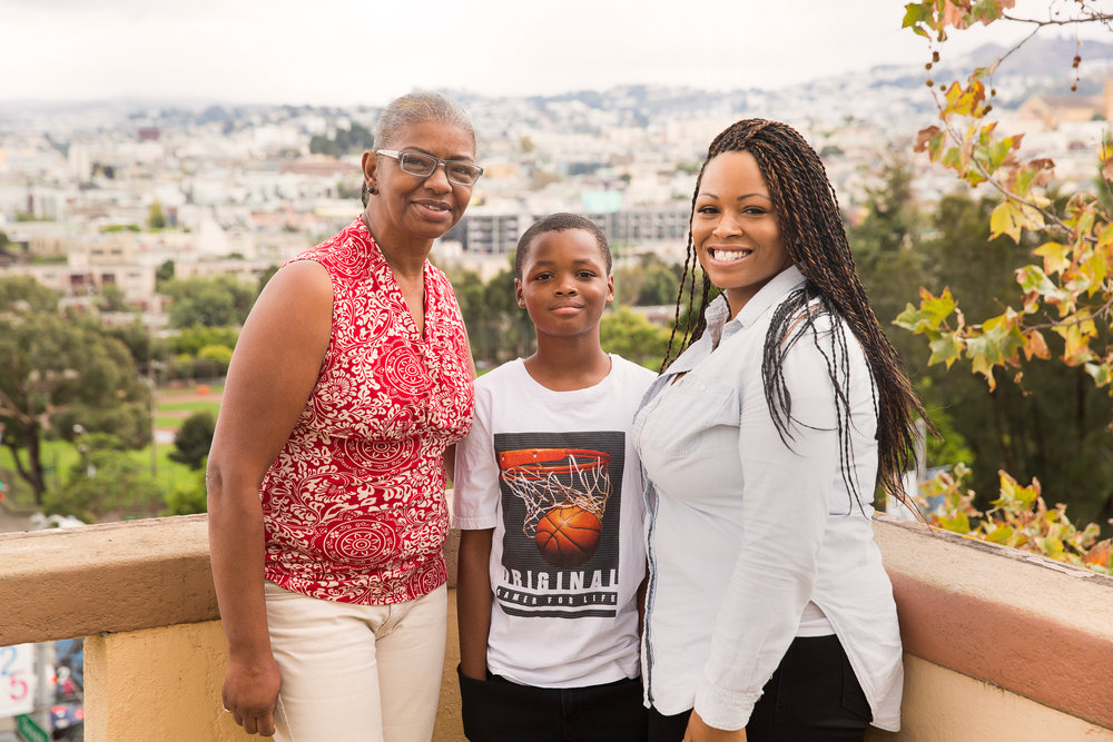 Catholic Charities Homeless Prevention Program Assistant Deborah Phillips with client Cecilia and her son.