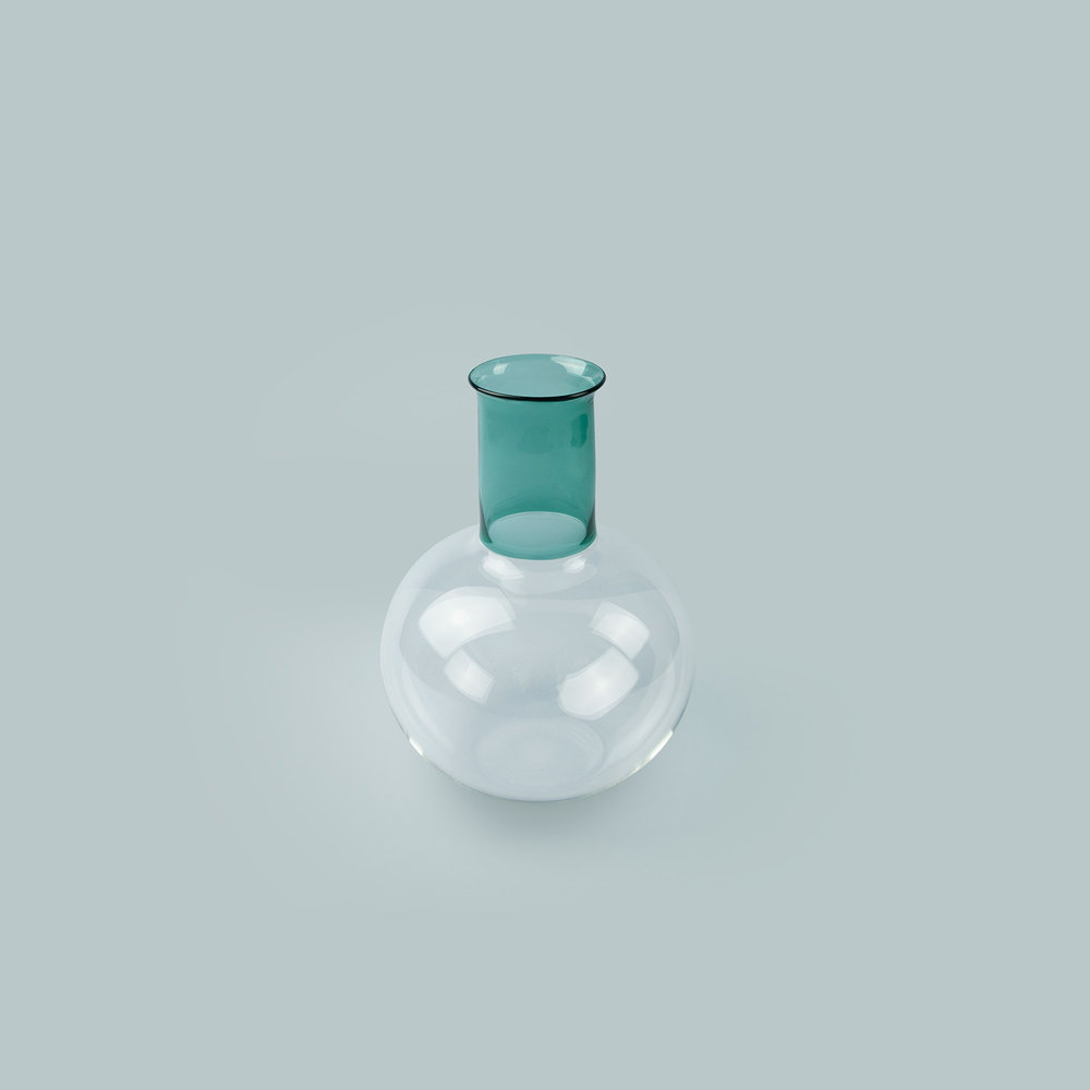 Vitro Vas: Teal   Description:  An elegant hand blown glass vase in two textures of glass.  Materials:  Borosilicate glass.  Dimensions:  Width: 15cm x Height: 25cm  £120