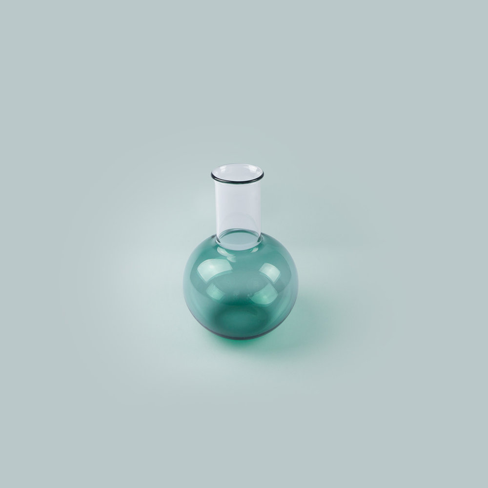 Vitro Vas: Teal Reverse   Description:  An elegant hand blown glass vase in two textures of glass.  Materials:  Borosilicate glass.  Dimensions:  Width: 11.5cm x Height: 17cm  £90