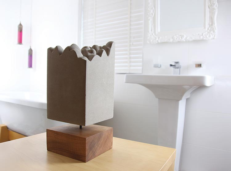 'Glacier'  Hand-carved stone original. Limestone, Musk wood, steel.  36cm x 15.5cm x 15cm  £650  'Glacier' was inspired by both an image made by a scanning tunnelling microscope of a DNA molecule and a song of the same name by John Grant.  The idea that an image of DNA resulted in a glacial looking landscape seemed to fit beautifully with the song lyrics, which compare the effects of suffering upon us with the 'spectacular landscapes' created by glaciers. The layers represent both the geological strata of the earth and the different regions seen as bands on human chromosomes but could equally point to our own emotional growth through layers of experience over time.