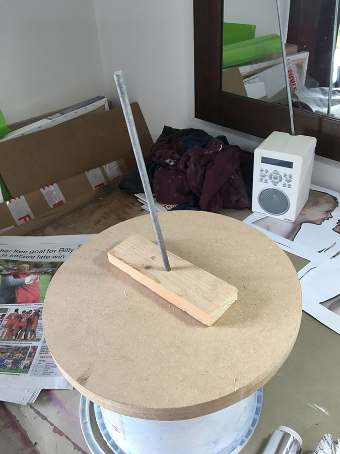 I made a simple armature (the metal rod and rectangular section of timber) to support the weight of the clay. Placing it on a circular wooden base means I can then rotate it easily as I'm working. Note the highly technical upturned tub below to allow for rotation. One of these days I will invest in proper banding wheel.
