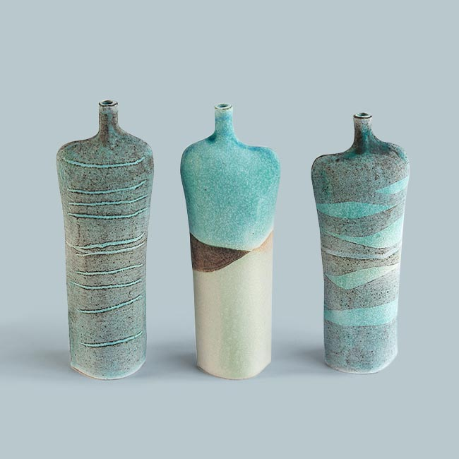 Kirsti Brown     Working from her home studio in Hawarden, Flintshire, Kirsti hand builds ceramic vessels influenced by the sea, beaches and cliffs around Wales and Scotland.