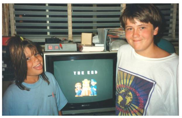 My sister and I defeat Super Mario Bros. 2 and then take a photo of it, as you do. Fun fact: I'm wearing a knock-off hyper color shirt in this photo.