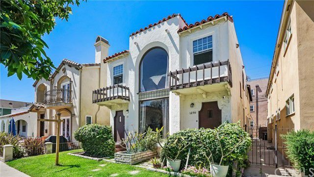 Spanish-style Duplex with Old World charm, amazing location