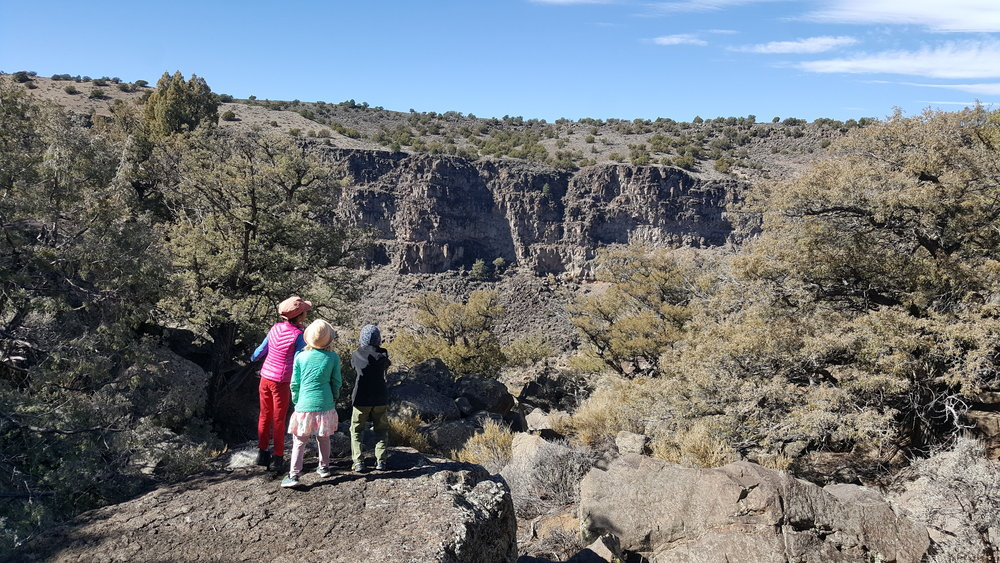 A view from inside Bone Canyon. These kids are shouting into the distance from Echo Rock. The cliffs in the distance provide an amazing 5-second delay crystal clear echo.