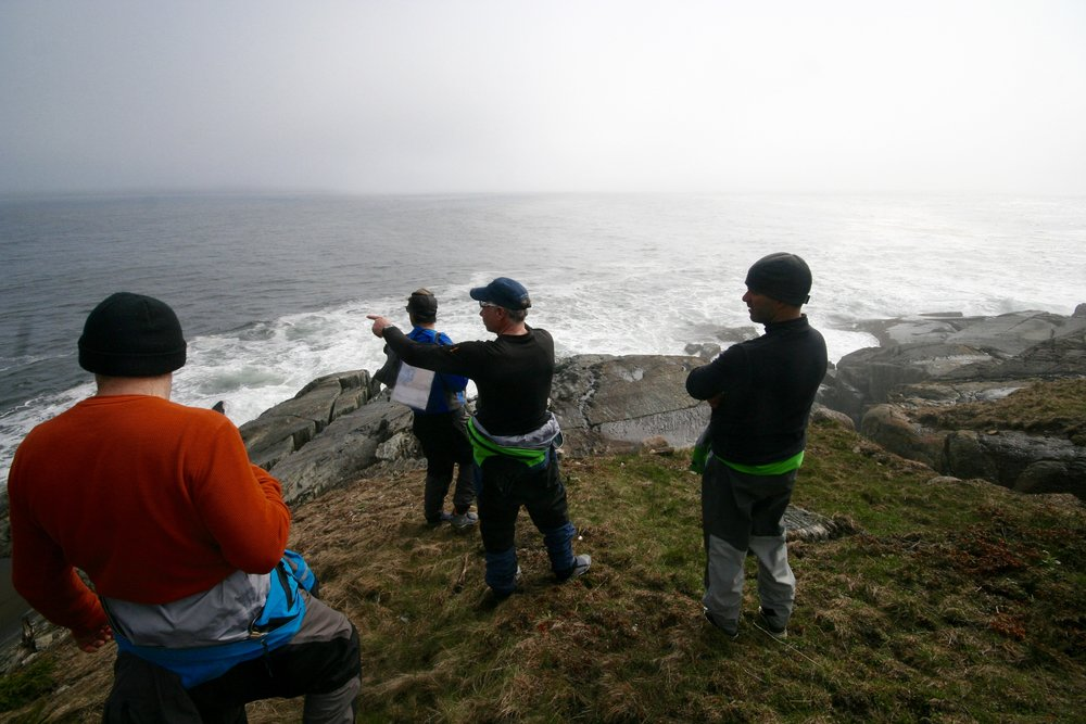 Checking the conditions from the Mosher Island Lighthouse, during our SUP Touring Level 1 & 2 Instructor course last year.