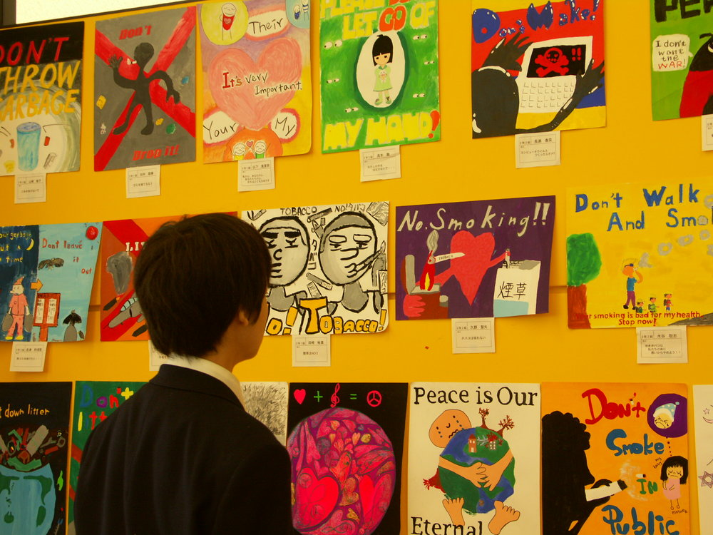 A display of middle school students' posters on issues they thought it was important for their peers to consider and be aware of. These students were also EFL learners