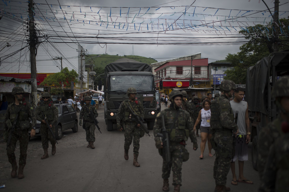 """March, 17, 2018. 9am. Three days after the crime, I was on assignment for Folha de São Paulo newspaper to cover a social action promoted by the Brazilian army, the mayor and the governor, at Vila Kennedy, Bangu, Rio de Janeiro. The place has high numbers in violence statistics and is being considered by the army as  the """"model"""" to the federal intervention  in the public security of the state."""