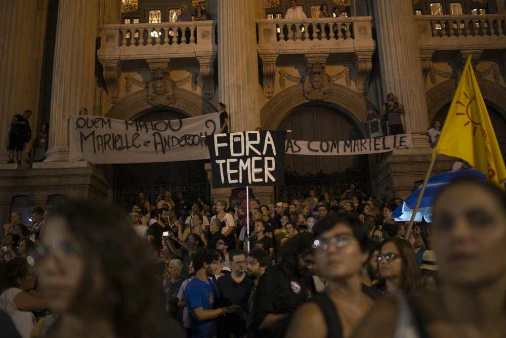 """March, 20, 2018. 8pm. The poster says """"Temer Out"""", referring to the president Michel Temer, in front of the Municipal Theatre."""