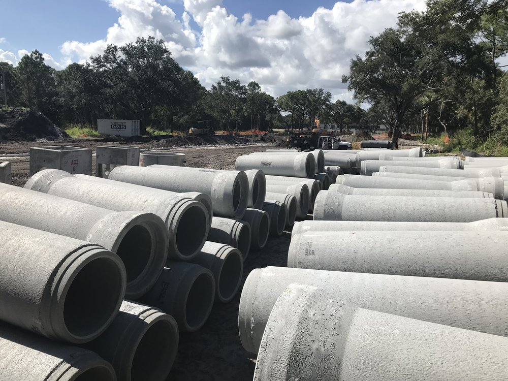 Drainage pipes lay on the Hospitality Park property, waiting to be placed.