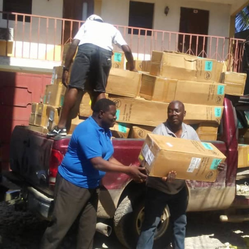 Unloading tents from the back of a truck in Haiti for Hosean International Ministries.