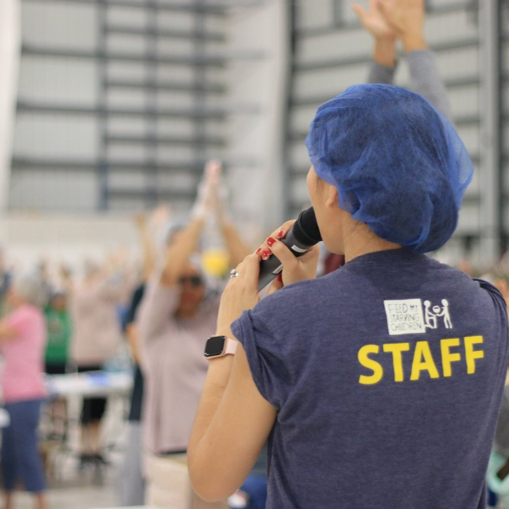 """Crystal, part of the FMSC MobilePack™ Staff, calls for """"all hands up"""" as she provides final instructions."""