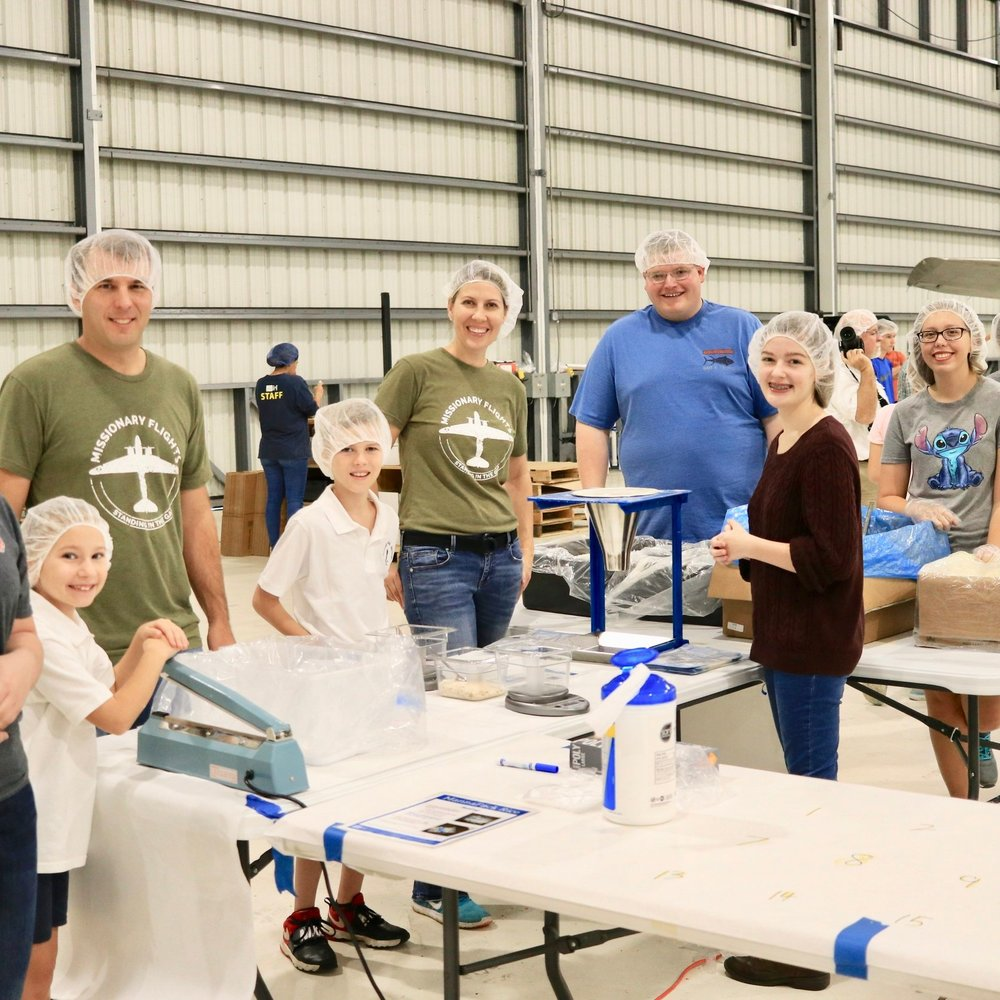 Pilot Ray & Tammy Oostdyk are joined by their daughter Julia, son Josiah, and other students from their church small group.