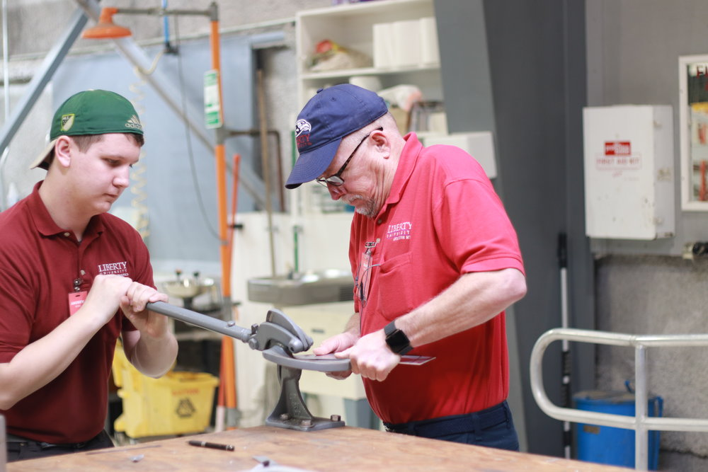 Dustin Wing and AMT Instructor, Dave Austin, work on a custom piece for N300MF.