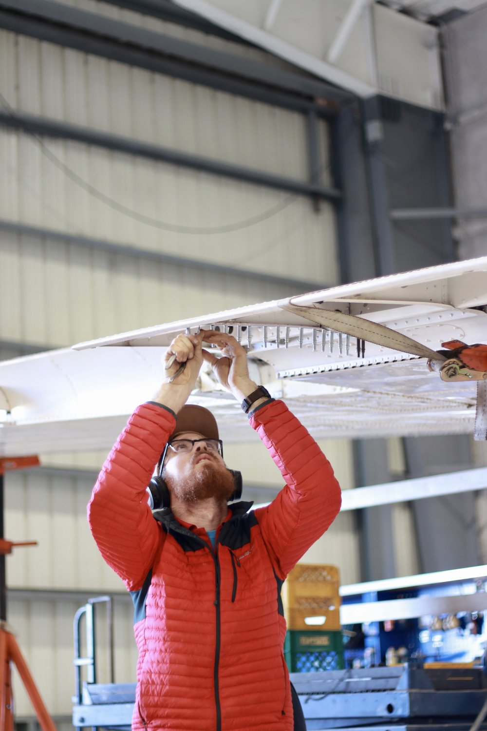 AMT Dustin Foster works on the wing