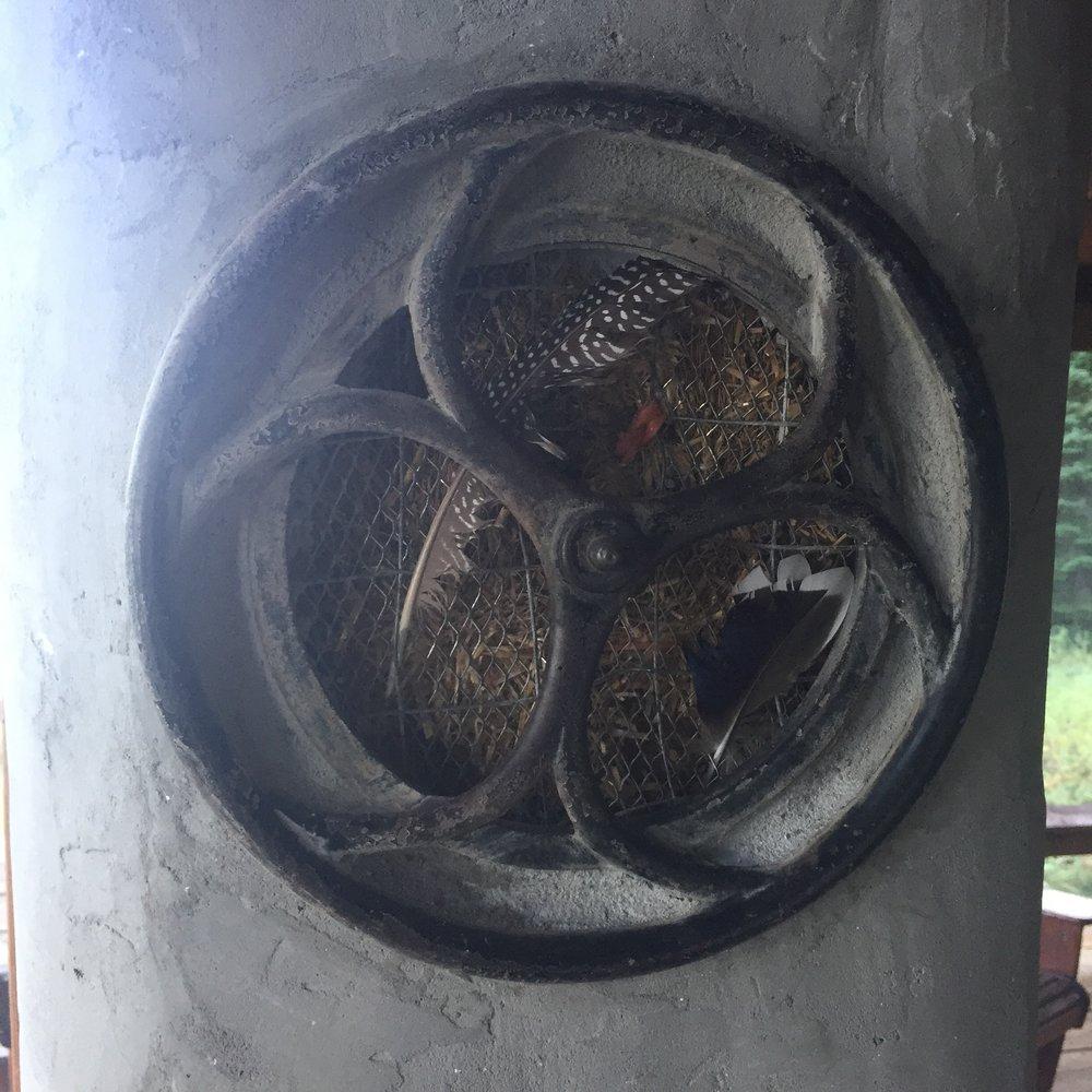 Stucco porthole exposing strawbale interior