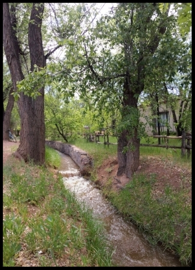 The city's main  acequia  runs through the historic Eastside neighborhood, next to Canyon Road