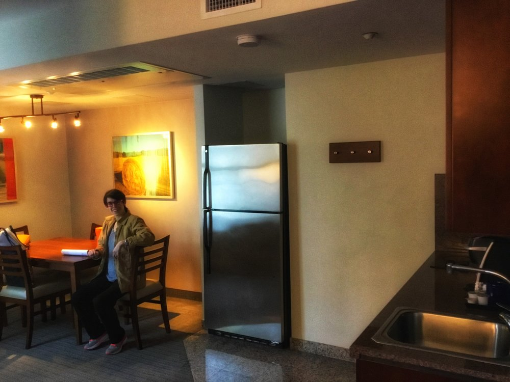My daughter in the full kitchenette + dining area