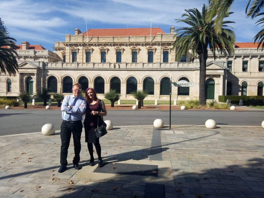 Associate Professor Sam Winter, a long time advocate for transgender equality, and Perth rock guitarist and trans advocate Jaime Page, outside the Western Australian Parliament House.