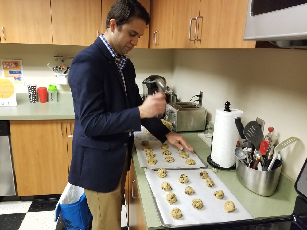 Co-founder Elisha Montgomery squishes the dough into enterprise-like discs for an even bake.