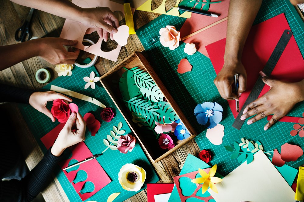 Hands working on crafts.