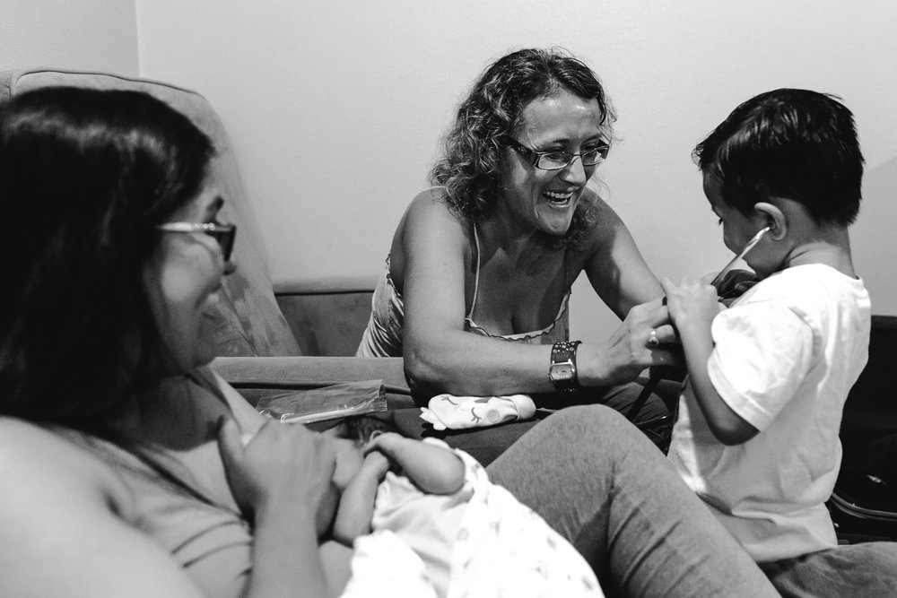 Happy International Day of The Midwife | Leading a newborn exam with big brother in Edinburg, TX. Midwife Nicole Mascarello. | rgvbirthphotography.com | Norma Hess Photography