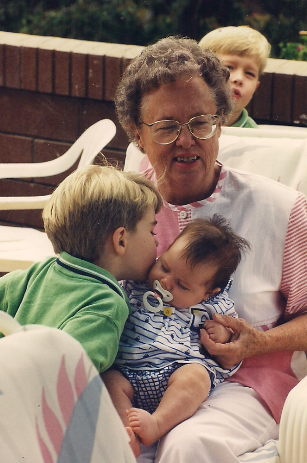 Trenton kissing Allison with Grandma and Austin looking on