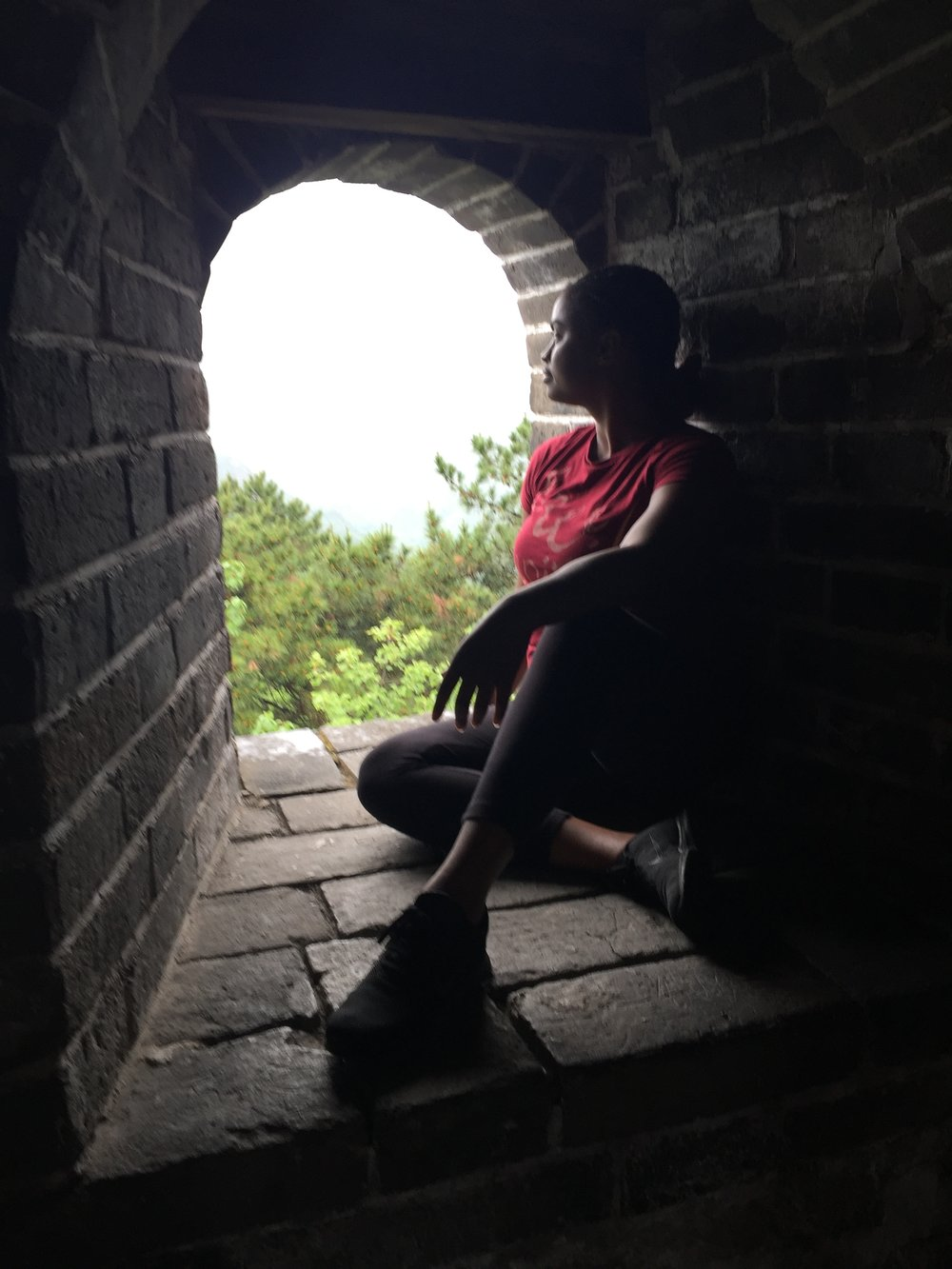 Shavonne observing the journey back down the Mutianyu path of the Great Wall.