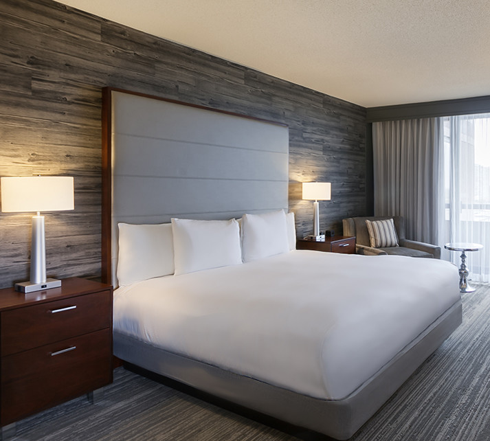For this guest suite, we showcased our love for leather by using it as part of the headboard.