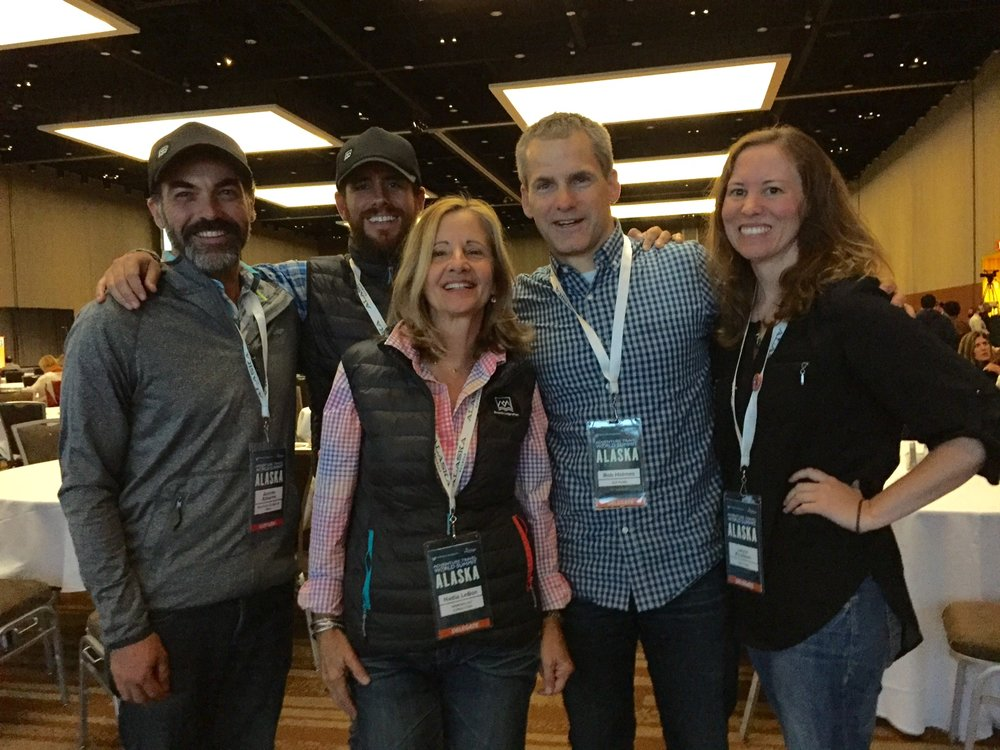 "Photo: Team members from GLP Films and Mountain Lodges of Peru in attendance at ATWS Alaska, just after ""Salkantay Inca Trail: The Ultimate Trek to Machu Picchu"" was announced as winner for the Adventure in Motion film contest. From left to right: Andrés Adasme, Enrique Umbert Jr., Nadia Le Bon, Rob Holmes, Laura Knudson"
