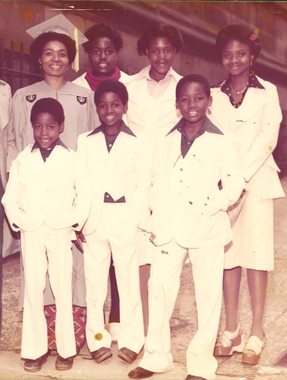 Dorcas Demasio, her five children and her niece (far right) after the matriarch overcame enormous odds to obtain a graduate degree from Columbia University in 1977. Queen Dorcas, also an alumna of New York University, ended up with three degrees.