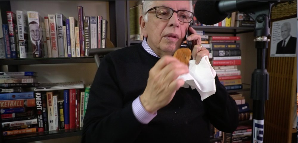 Pre-interview: David munches on an oatmeal cookie while checking on his voicemail.
