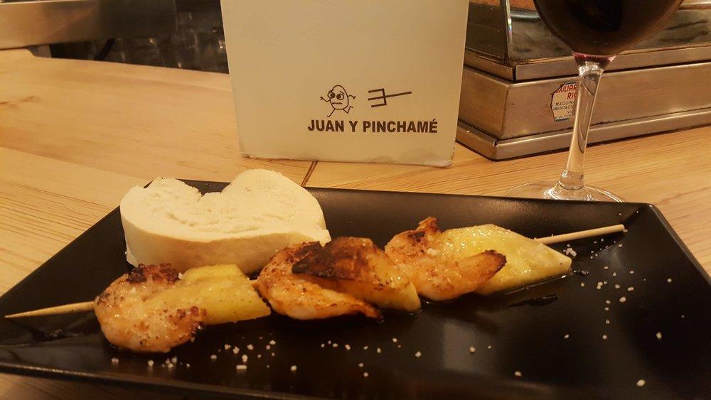 Grabbing my favorite pincho on Calle Laurel in Logroño