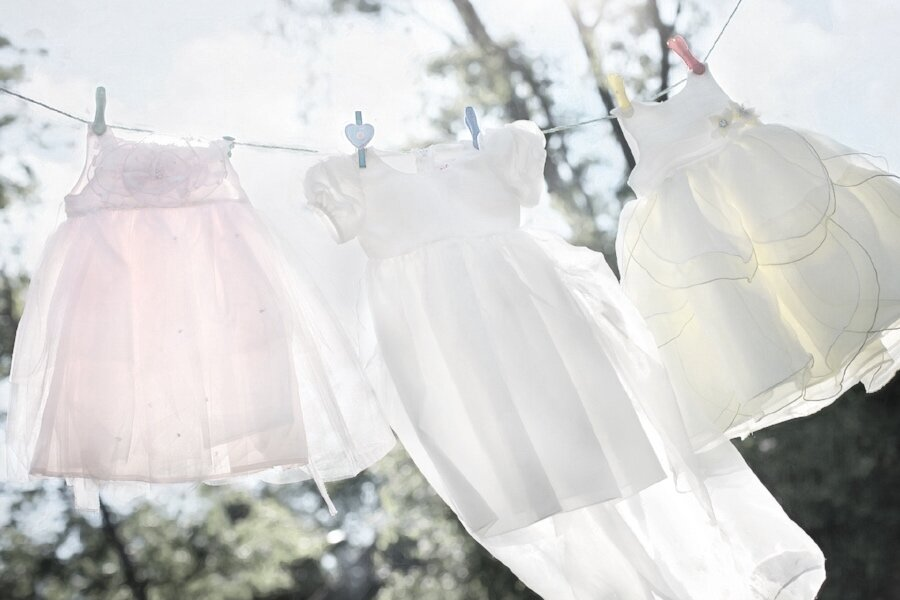 washing line with little girl dresses.jpg
