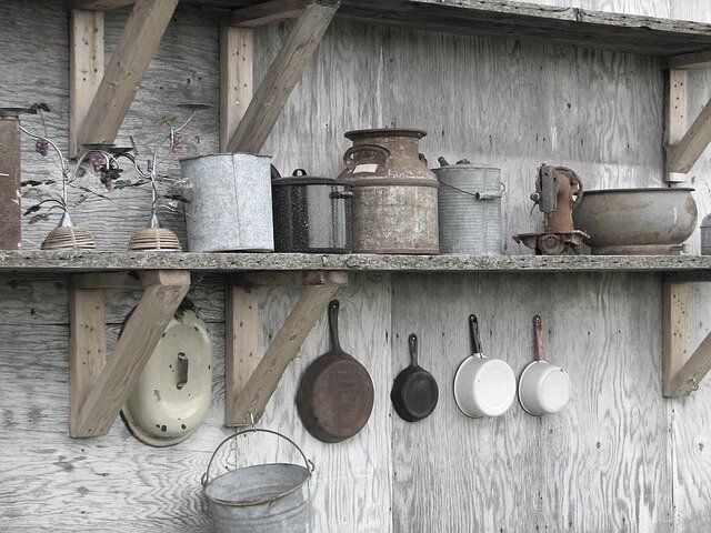 pots and pans hanging on timber wall old.jpg