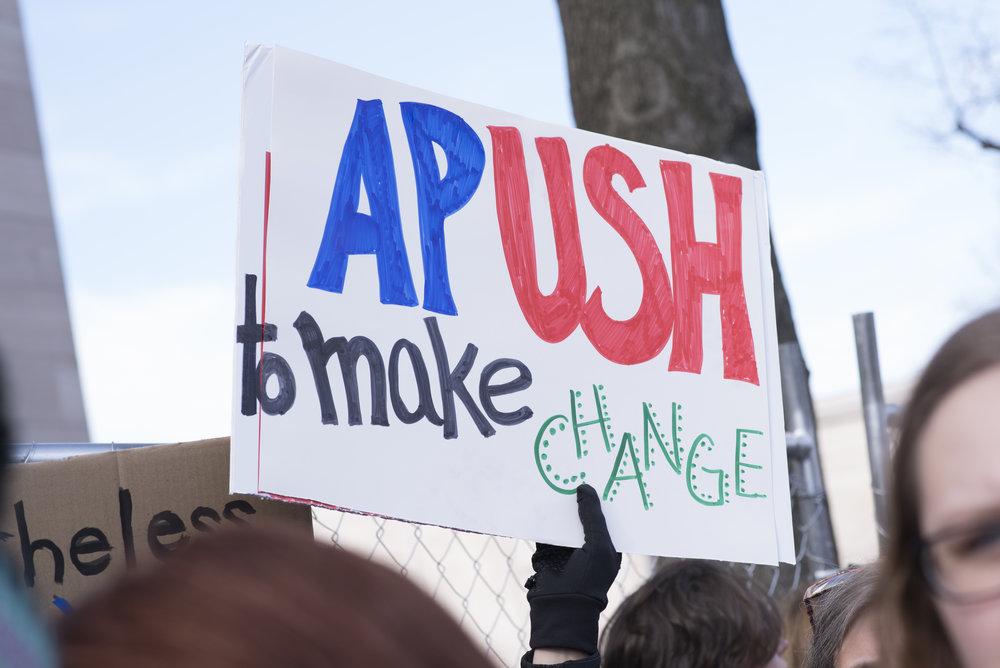 "March for Our Lives, Washington, DC: March 24, 2018.  Student holding sign, ""APUSH to make change."""