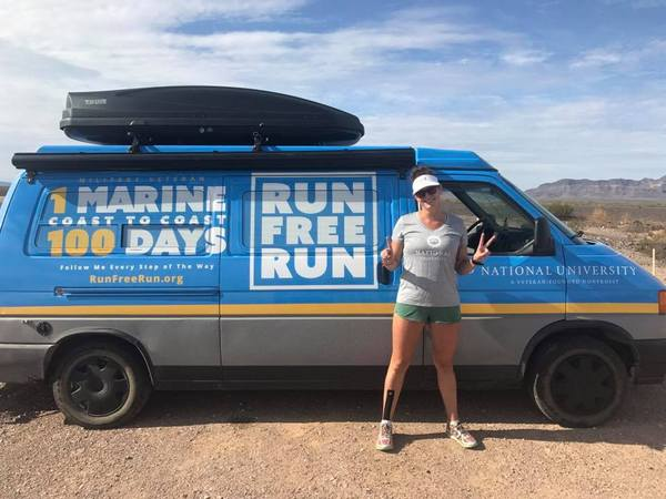 - Maggie in front of the National University Run Free Run support vehicle