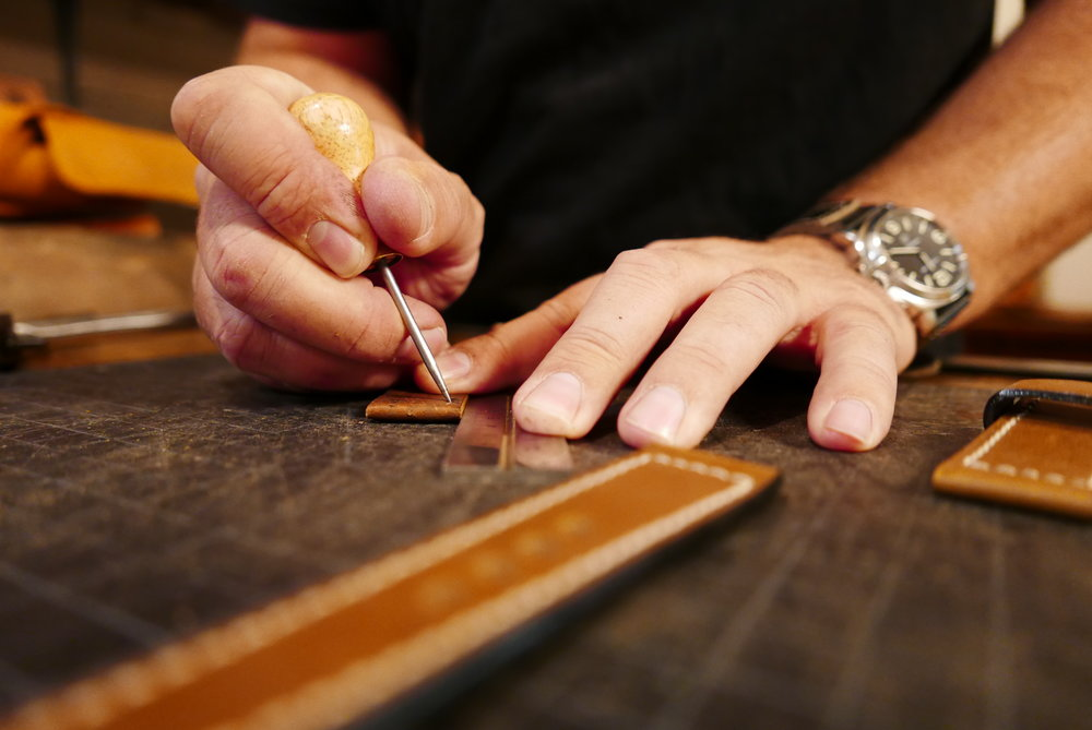 Greg Stevens prepares one of his custom-made straps.