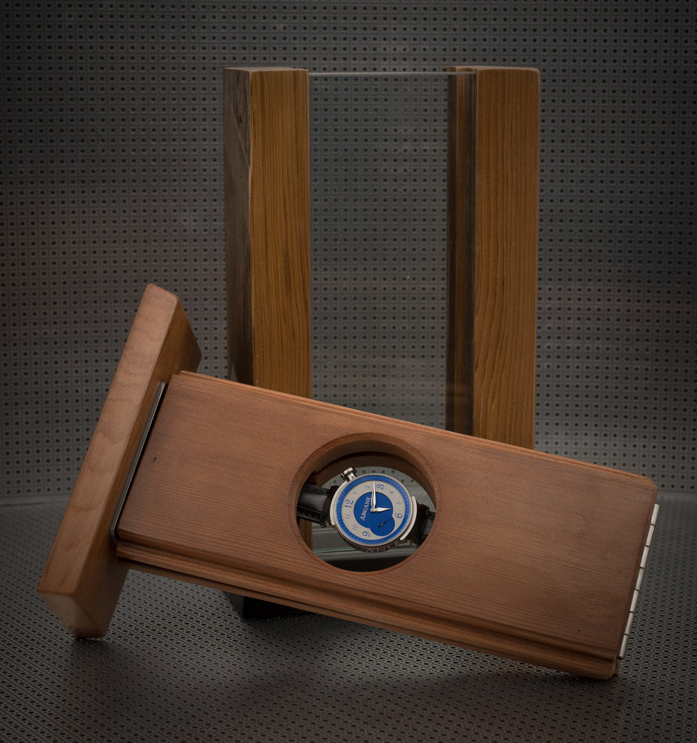 The custom dual-sided display case is handcrafted from salvaged old-grown cedar and paperstone.