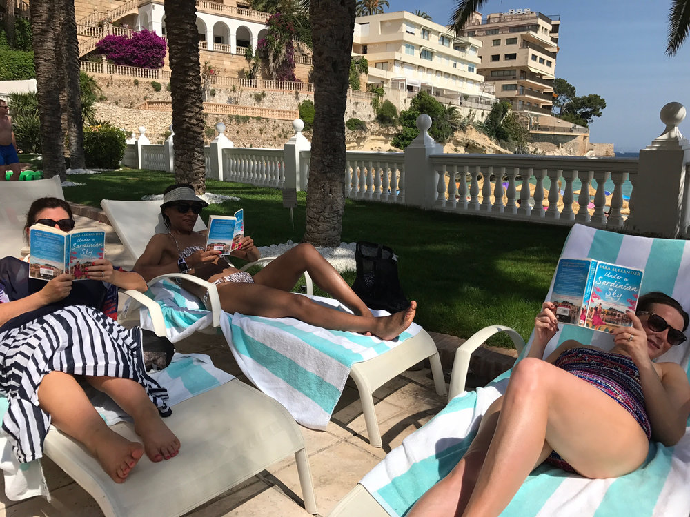 A bookclub from Hertfordshire, UK, taking Under a Sardinian Sky on their sunny European escape