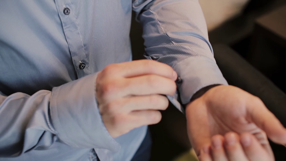 videoblocks-close-up-view-of-young-male-hands-getting-dressed-at-morning-man-buttons-cuffs-on-a-shirt-preparing-for-work_rwmgz6ubre_thumbnail-full01.png