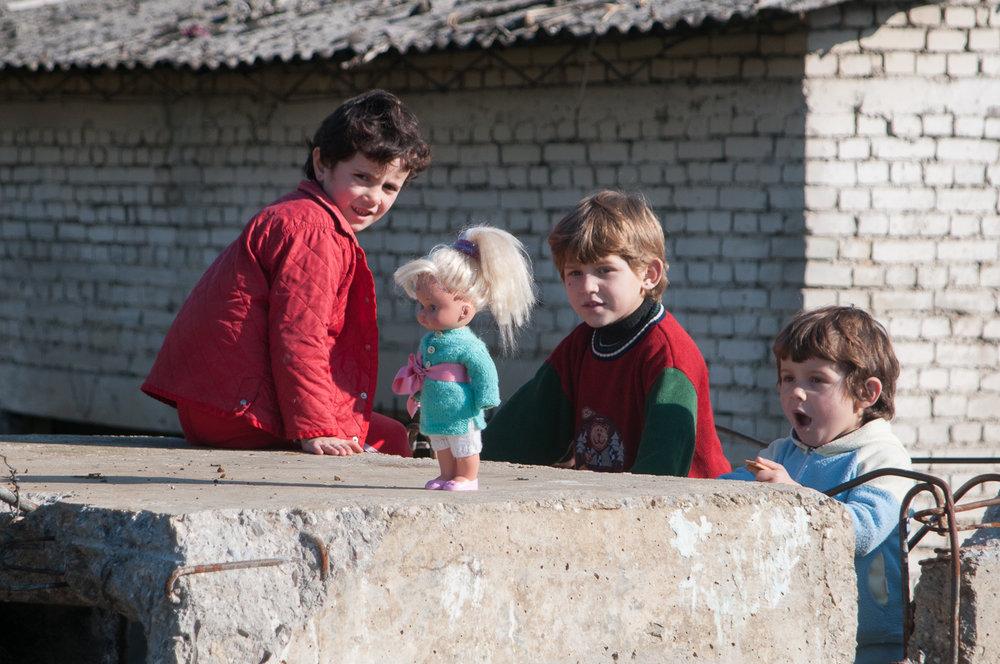 Children playing in former mine buildings, Krabbë, Albania