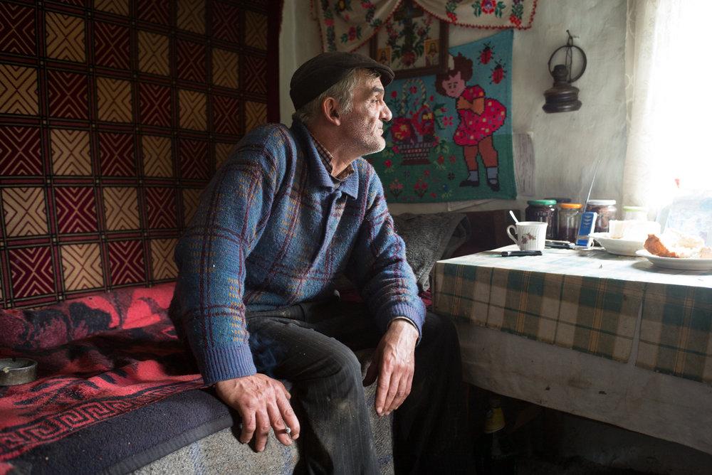Elderly farmer at home, Voineasa, Romania