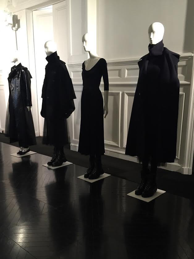 Austere, moody outerwear over long, black tutu dresses.
